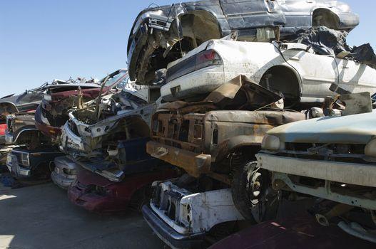 Stack of damaged cars in a junkyard