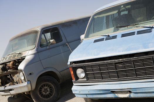 Obsolete mini vans in junkyard