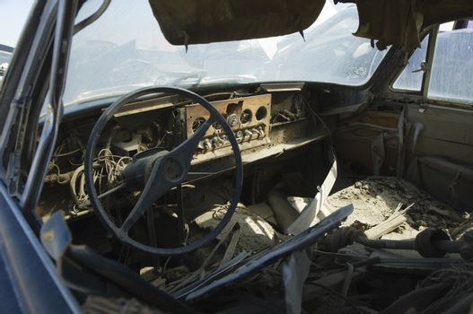 Interior of an old wrecked car at junkyard