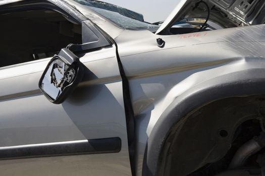Damaged motor vehicle at junkyard