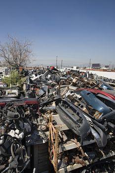 Torn out and broken up vehicle parts at junkyard