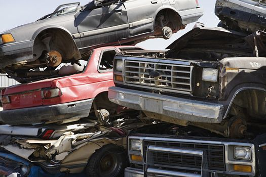 Stack of worn out and brokendown cars at junkyard