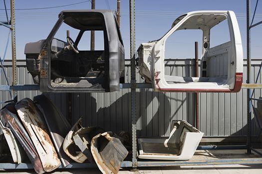Worn out car parts at scrap yard