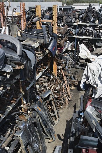 High angle view of wrecked and broken down car parts at an automotive junkyard