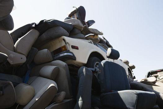 Heap of car seats in junkyard