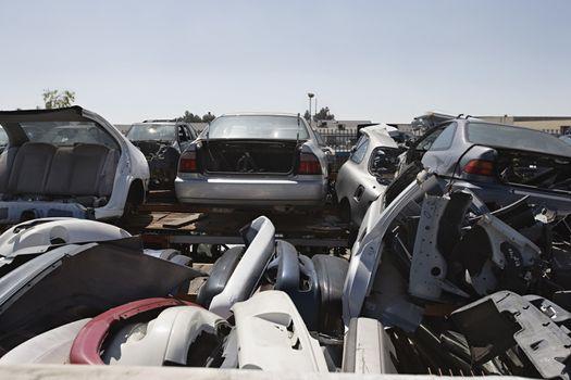 Damaged vehicles at an automotive scrap yard