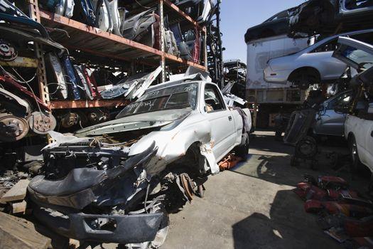 Wrecked cars and vehicle parts at scarp yard