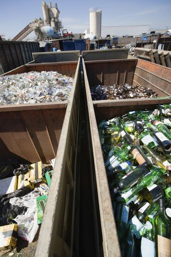 Domestic waste in bins at recycling plant