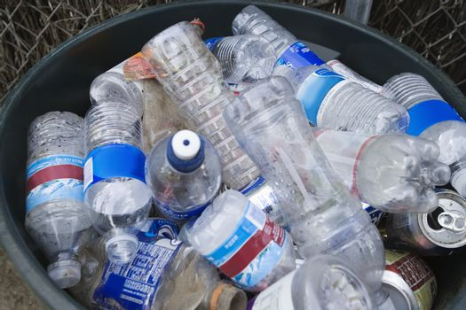 High angle view of plastic bottles in bin