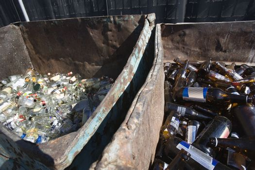High angle view of thrown bottles in bin