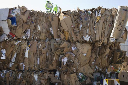 Stacked cardboard boxes in junkyard