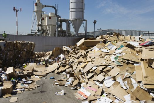 Pile of cardboard boxes in recycling center