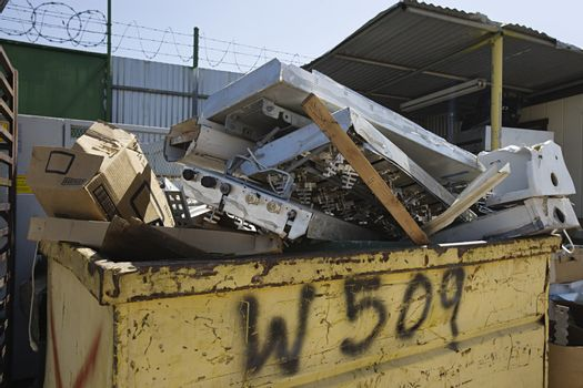 Heap of garbage in waste container