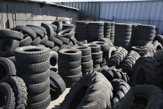 Stacked old tires in recycling center