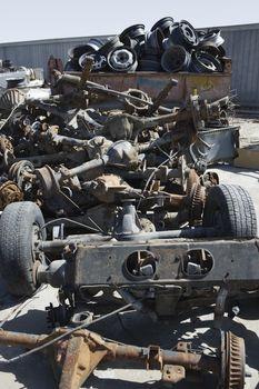 Pile of rusty car parts at junkyard
