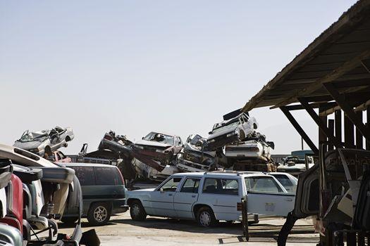 Cars stacked in junkyard