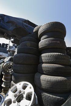 Pile of tires at an automotive junkyard