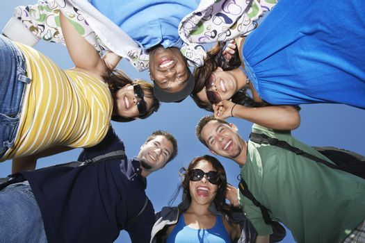 Group of young people in circle view from below