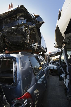 Damaged and broken down cars in an automotive junkyard
