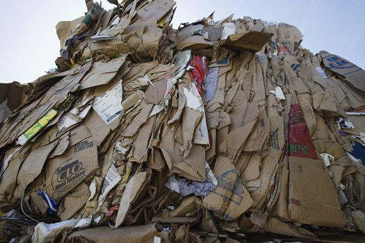Heap of cardboard boxes in junkyard