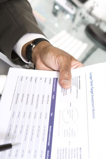Cropped shot of a businessman's hand with investment papers
