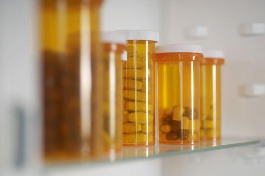 Bottles of pills on shelf