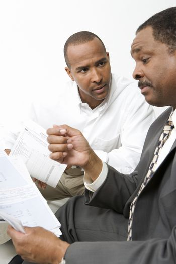 Man talking with accountant over personal expenses