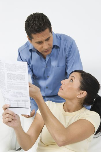 Worried couple finding difficulty in calculating home finance
