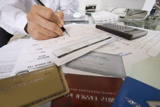 Closeup of businessman filling credit card forms