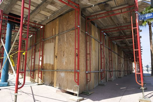 Scaffolding around boarded up property
