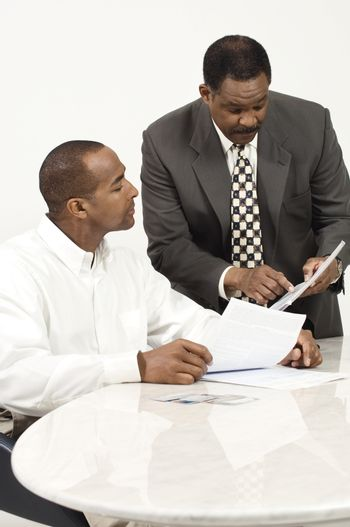 African American business people in meeting at office desk
