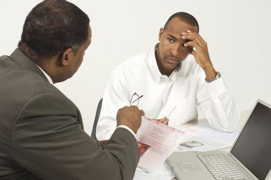Financial Advisor In Discussion With Tensed Businessman
