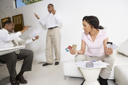 Accountant in discussion with couple over excess credit card expenses