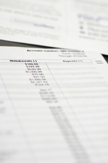 Closeup of withdrawal and deposit receipt