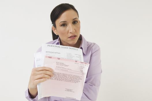 Portrait of a angry business woman holding loan documents isolated over white background