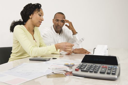 An African American couple planning their financial budget at home