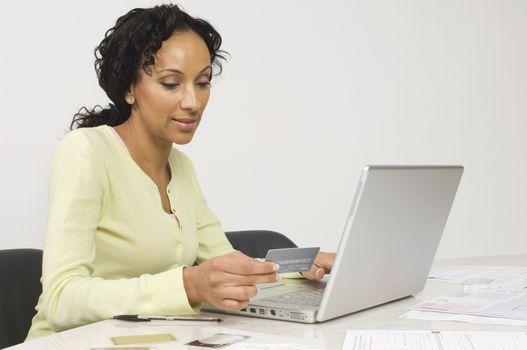 Beautiful African American woman doing an online transaction
