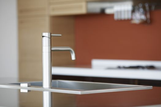 Closeup of faucet in kitchen