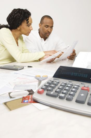 Couple planning their financial budget at home