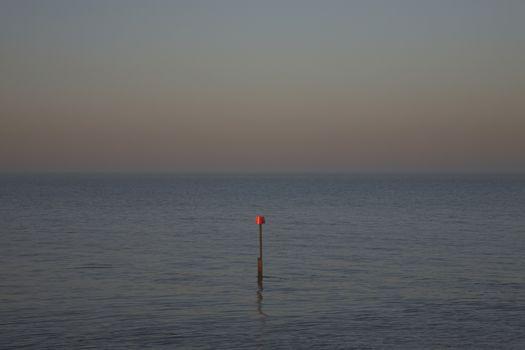 Beacon in ocean at dusk