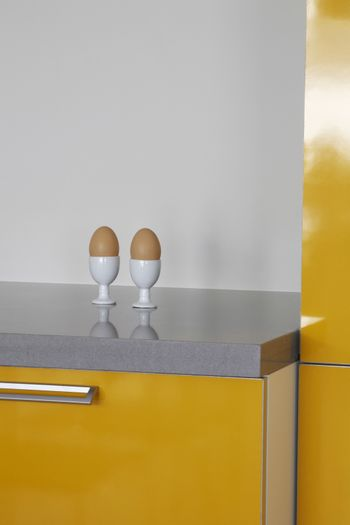 Closeup of eggs in eggcups on kitchen counter
