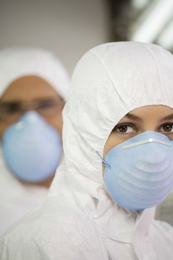 Portrait of agricultural scientists wearing mask and overalls