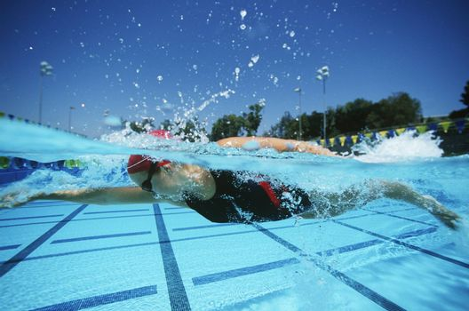 Professional female swimmer practicing before a competition