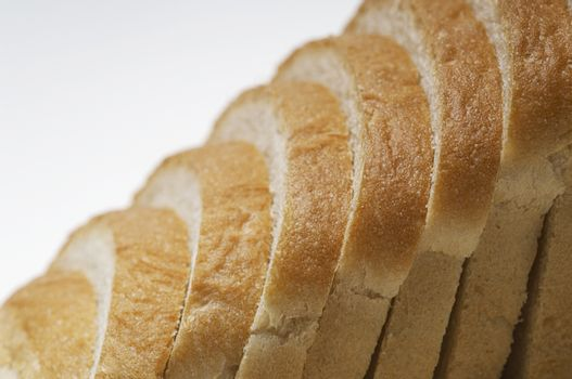 Closeup of sliced breads isolated over white background