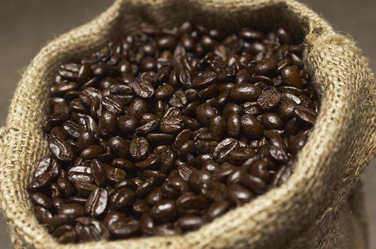 Closeup of a burlap sack full of coffee beans