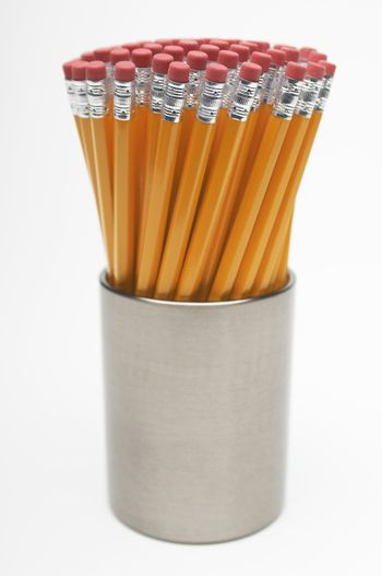 New pencils in container isolated over white background
