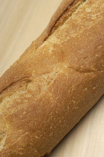 Closeup of a baguette on chopping board