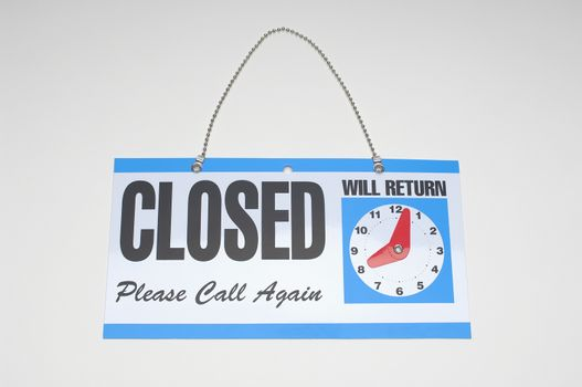 Closeup of isolated signboard with text over white background