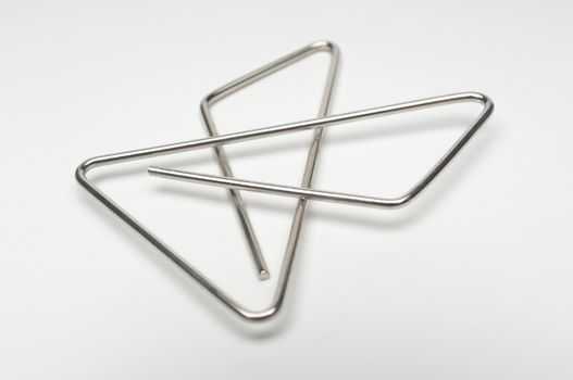 Steel paperclip isolated over white background