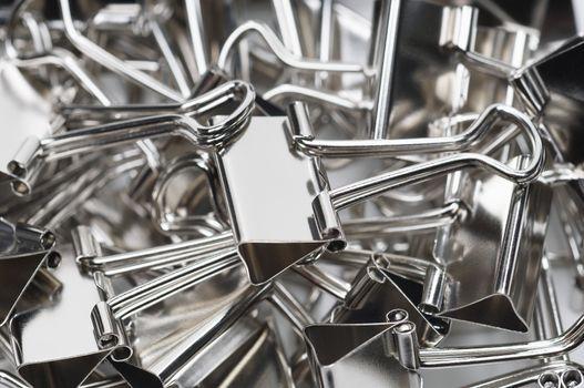 Heap of chrome binder clips